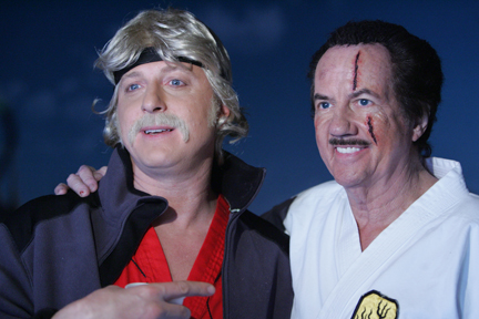 "Billy Zabka (""The Karate Kid"") and Bob Wall (reprising his O'Hara character) on the set of a commerical for TwinLab."