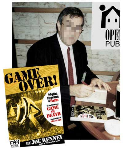 Joe Kenney, author of GAME OVER!, signing his book. Joe asked me to have his face covered to hide his identity.