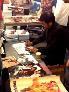 Hwang Jang Lee signing memorabilia for fans.